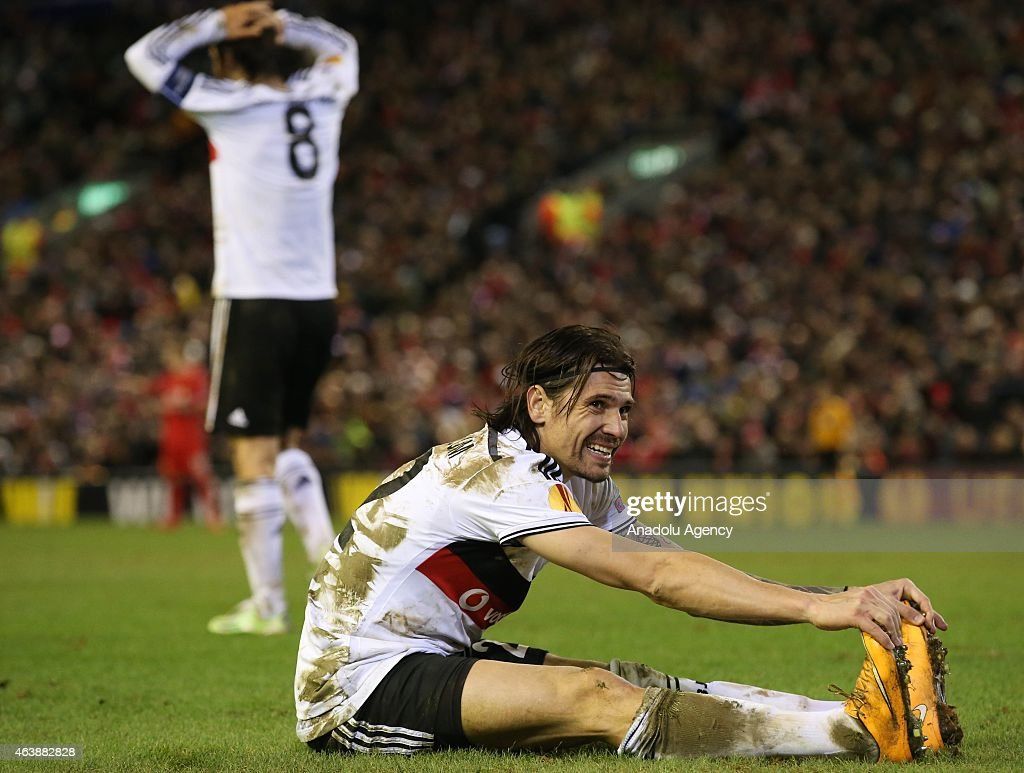 Ersan Gulum of Besiktas reacts during the UEFA Europa League Round of 32 match between Liverpool and Besiktas at Anfield Stadium in Liverpool on February 19 2015.