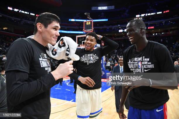 Ersan Ilyasova and Giannis Antetokounmpo of the Milwaukee Bucks laugh with Thon Maker of the Detroit Pistons after a game on February 20, 2020 at...