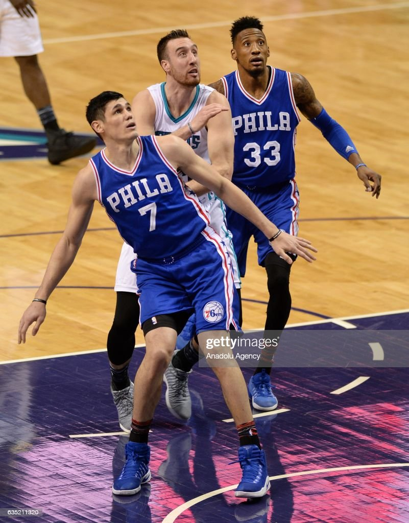 Ersan Ilyasova (7) and Robert Covington (R) of Philadelphia 76ers along with Frank Kaminsky (C) of Chrlotte Hornets watch for the ball during the NBA match between Philadelphia 76ers vs Charlotte Hornets at the Spectrum arena in Charlotte, NC, USA on February 13, 2017.