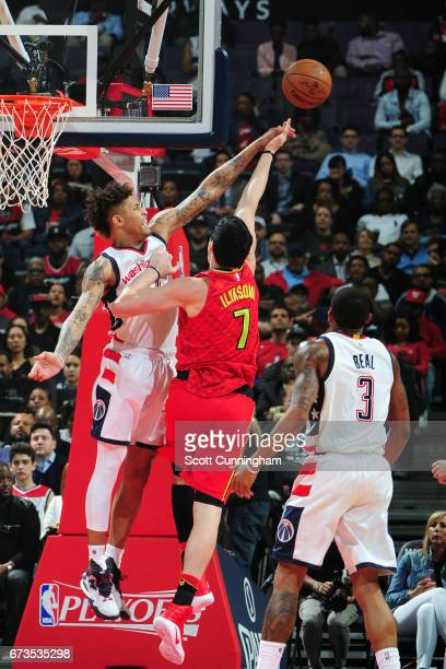 Ersan Ilyasova of the Atlanta Hawks goes for a lay up and gets blocked by Kelly Oubre Jr #12 of the Washington Wizards in Game Five of the Eastern...