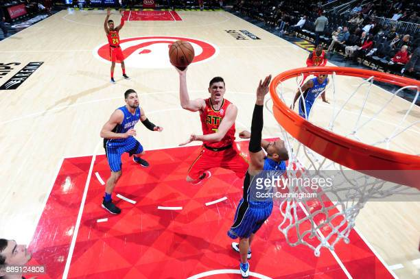 Ersan Ilyasova of the Atlanta Hawks shoots the ball against the Orlando Magic on December 9 2017 at Philips Arena in Atlanta Georgia NOTE TO USER...