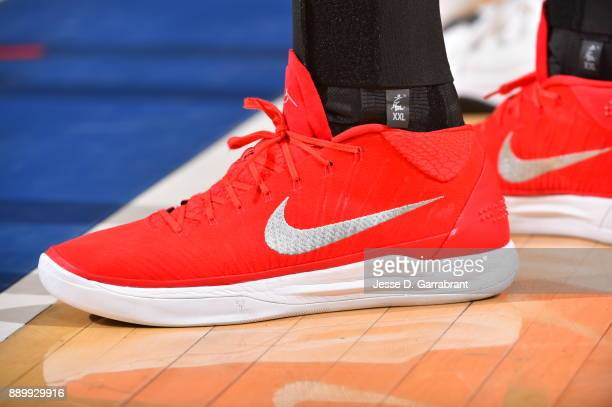 Ersan Ilyasova of the Atlanta Hawks showcases his sneakers against the New York Knicks at Madison Square Garden on December 10 2017 in New York New...