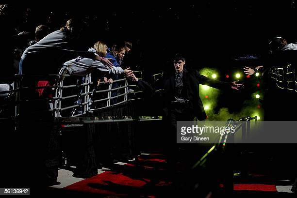 Ersan Ilyasova of the Milwaukee Bucks greets fans as he comes out of the tunnel during player introductions against the Miami Heat during a NBA game...