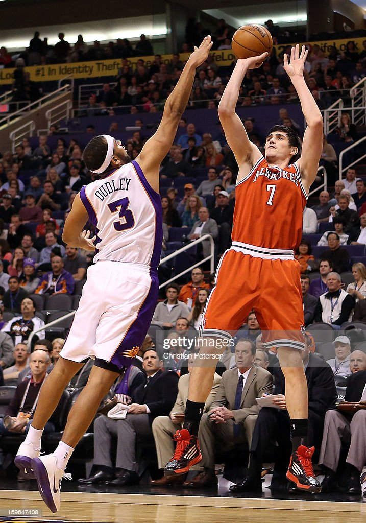 Ersan Ilyasova #7 of the Milwaukee Bucks puts up a shot against Jared Dudley #3 of the Phoenix Suns during the NBA game at US Airways Center on January 17, 2013 in Phoenix, Arizona.