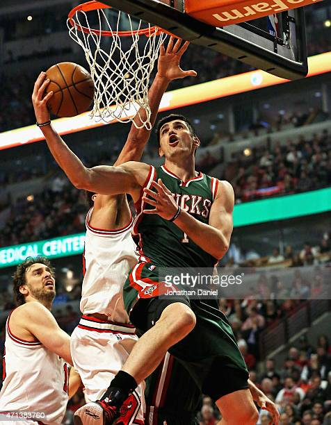 Ersan Ilyasova of the Milwaukee Bucks puts up a shot past Joakim Noah of the Chicago Bulls during the first round of the 2015 NBA Playoffs at the...