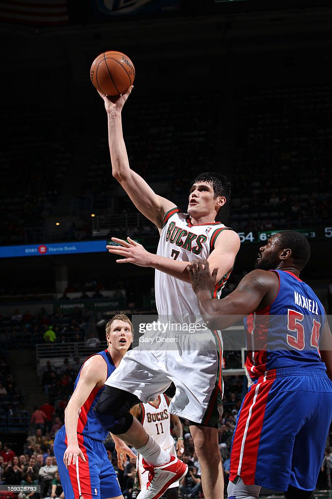 Ersan Ilyasova #7 of the Milwaukee Bucks shoots against Jason Maxiell #54 of the Detroit Pistons on January 11, 2013 at the BMO Harris Bradley Center in Milwaukee, Wisconsin.
