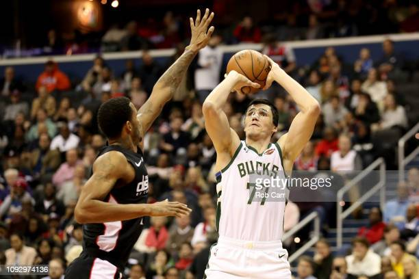 Ersan Ilyasova of the Milwaukee Bucks shoots over Trevor Ariza of the Washington Wizards at Capital One Arena on January 11 2019 in Washington DC...