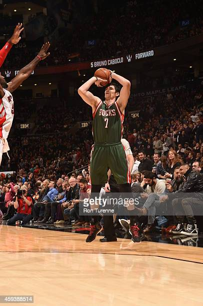Ersan Ilyasova of the Milwaukee Bucks shoots the ball against the Toronto Raptors during the game on November 21 2014 at the Air Canada Centre in...