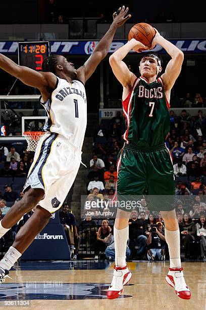 Ersan Ilyasova of the Milwaukee Bucks shoots under pressure against DeMarre Carroll of the Memphis Grizzlies during the game on November 21 2009 at...