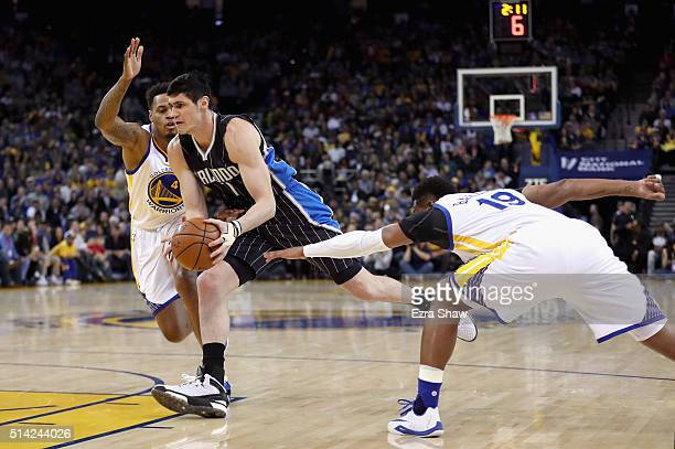 Ersan Ilyasova of the Orlando Magic drives between Brandon Rush and Leandro Barbosa of the Golden State Warriors at ORACLE Arena on March 7 2016 in...