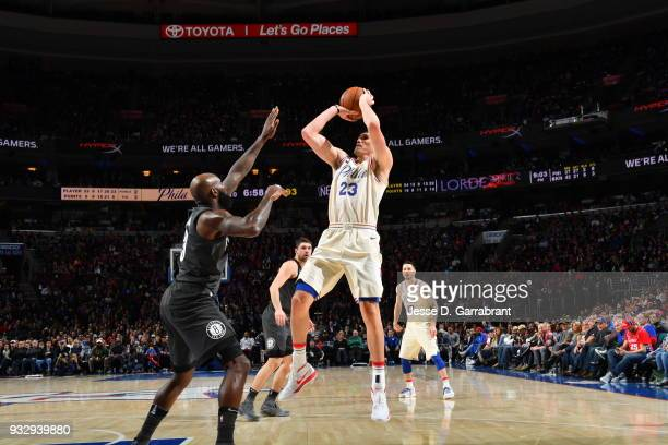 Ersan Ilyasova of the Philadelphia 76ers shoots the ball against the Brooklyn Nets at the Wells Fargo Center on March 16 2018 in Philadelphia...