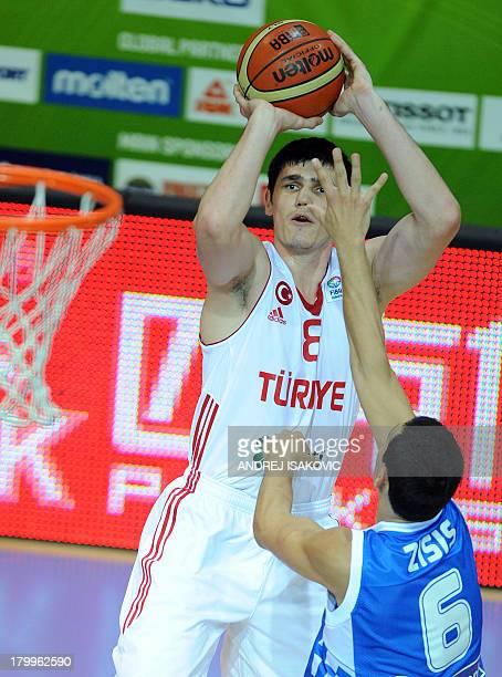 Ersan Ilyasova of Turkey prepares to shoot the ball over Nikos Zisis of Greece during their FIBA Eurobasket 2013 Group D qualification match Turkey...