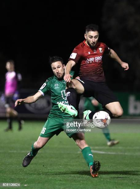 Ersin Kaya of Hume City gets thr ball ahead of Lambros Honos of Bentleigh Greens during the FFA Cup round of 32 match between Hume City FC and...