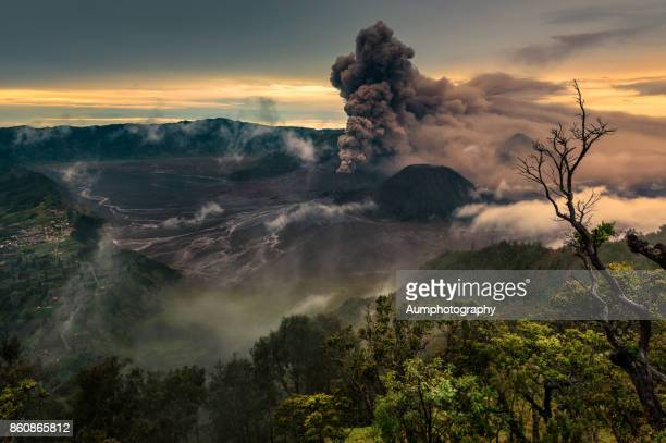 eruption of bromo volcano - mt bromo stock photos and pictures