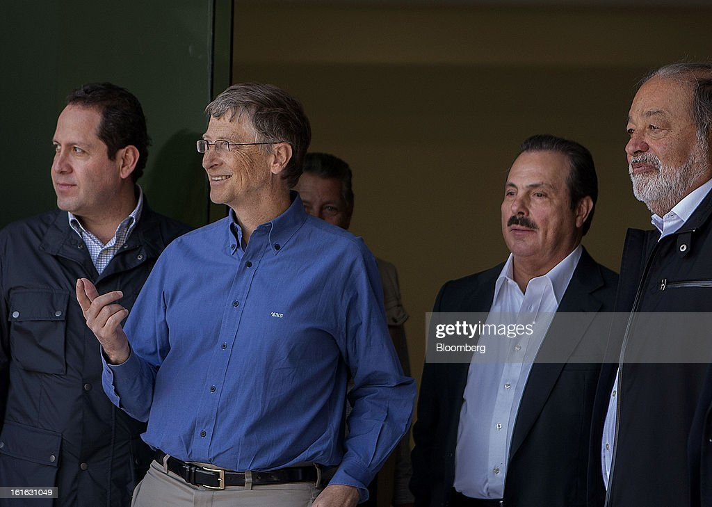 Eruviel Avila Villegas, governor of state of Mexico, from left, billionaire Bill Gates, Enrique Martinez, Mexico's minister of Agriculture, and billionaire Carlos Slim wait for the start of a news conference to announce donations to Mexico's International Maize and Wheat Improvement Center, known by its Spanish initials as CIMMYT, in Texcoco, Mexico, on Wednesday, Feb. 13, 2013. The group, which performs research for agricultural productivity, opens its research facility this week. Photographer: Susana Gonzalez/Bloomberg via Getty Images