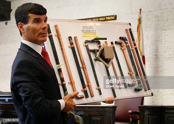 Ervin Gonzalez attorney for the Armin and Lisa Seifart shows an example of the damage Chinese drywall can do to pipes on Tuesday June 8 at the Dade...