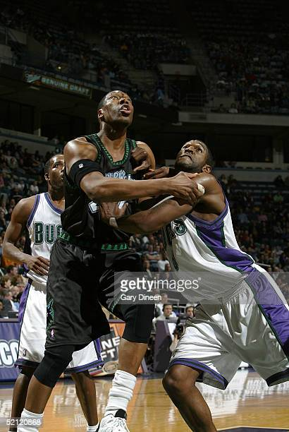 Ervin Johnson of the Minnesota Timberwolves and Joe Smith of the Milwaukee Bucks battle for position while looking for a rebound on February 1, 2005...