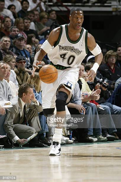 Ervin Johnson of the Minnesota Timberwolves moves the ball up court during the game against the Denver Nuggets at Target Center on March 21 2004 in...