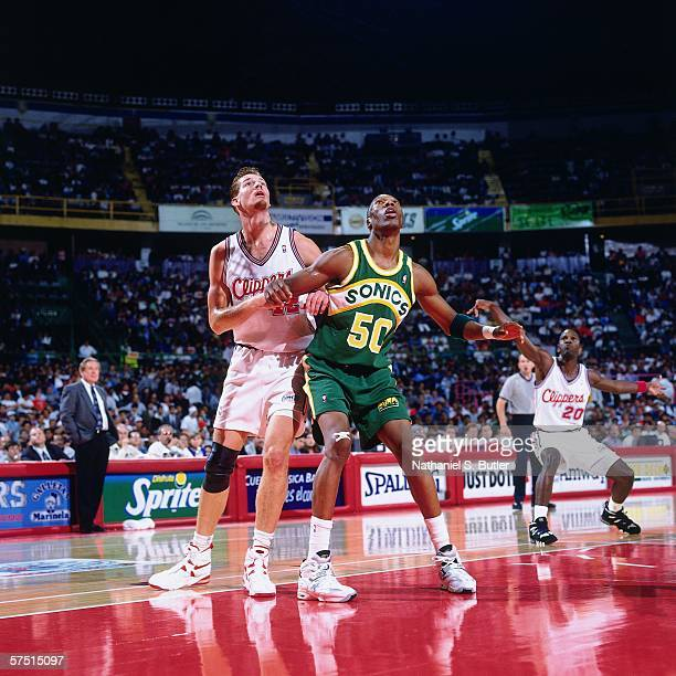 Ervin Johnson of the Seattle Supersonics boxes out against the Los Angeles Clippers during the 1994 NBA Challenge at the Palacio de los Deportes on...