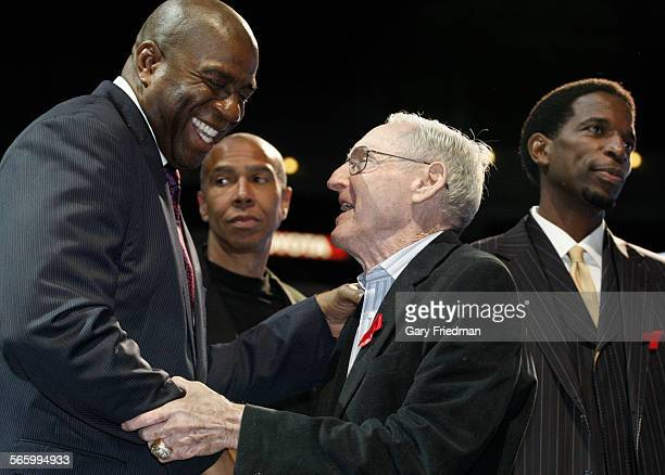 Ervin 'Magic' Johnson is greeted by former Laker coach Bill Sharman at a news conference on the 20th anniversary Magic's departure from basketball at...