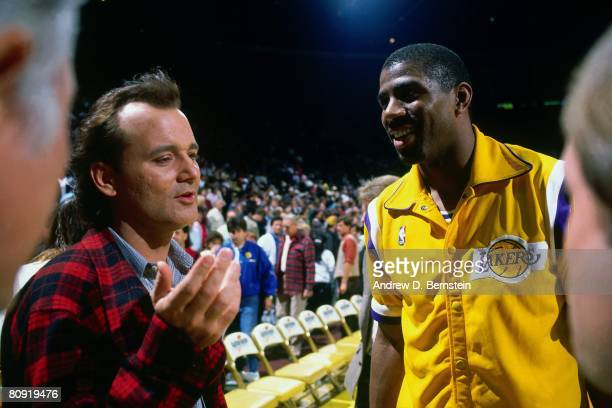 "Ervin ""Magic"" Johnson of the Los Angeles Lakers and actor Bill Murray talk prior to a game played in 1988 at the Great Western Forum in Inglewood,..."