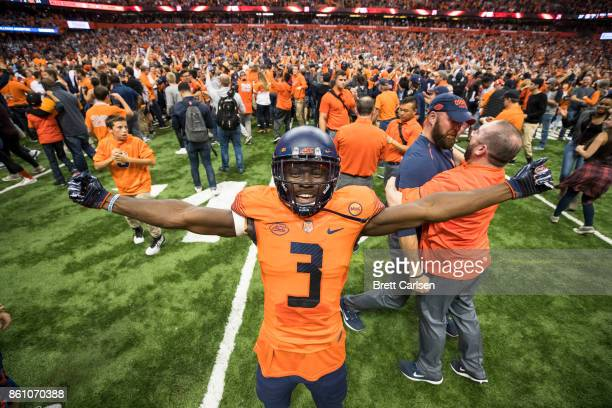 Ervin Philips of the Syracuse Orange celebrates the upset win over Clemson Tigers after fans storm the field at the Carrier Dome on October 13 2017...