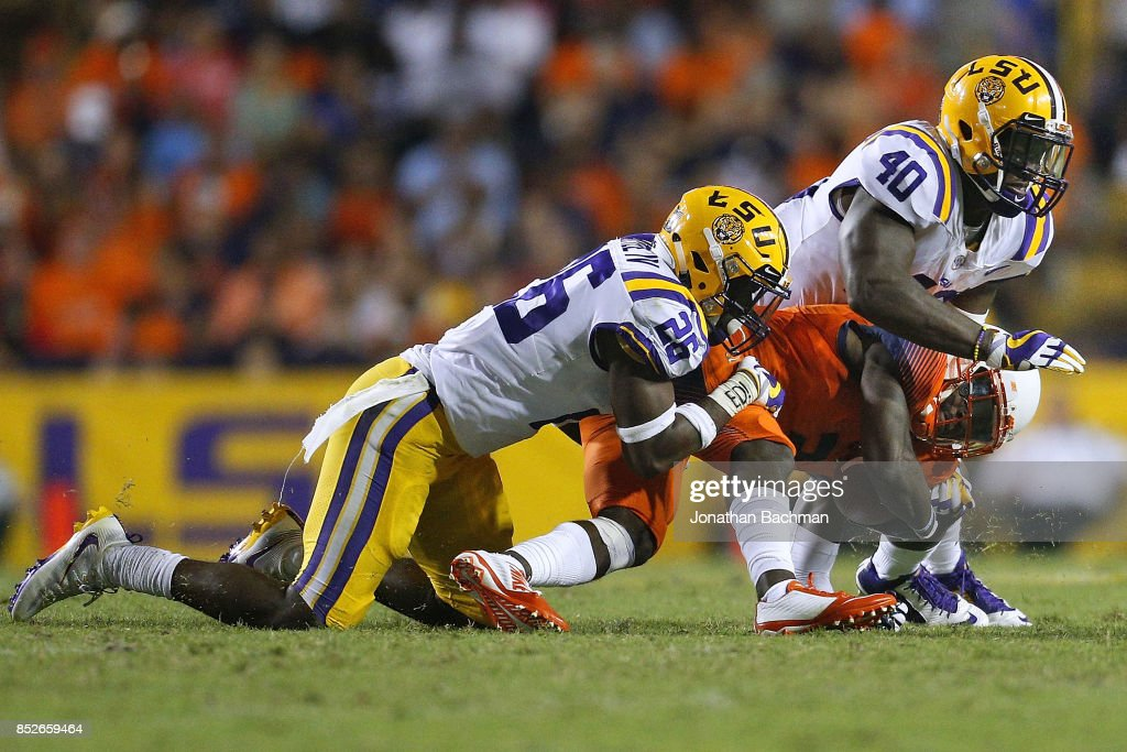 Ervin Philips #3 of the Syracuse Orange is tackled by John Battle #26 of the LSU Tigers and Devin White #40 during the second half of a game at Tiger Stadium on September 23, 2017 in Baton Rouge, Louisiana.