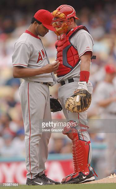 Ervin Santana of Los Angeles Angels meets on the mound with Mike Napoli during their Interleague contest against the Los Angeles Dodgers at Dodger...