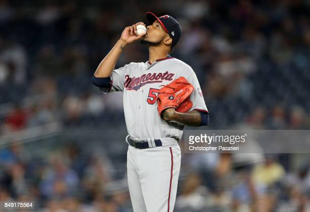 Ervin Santana of the Minnesota Twins kisses the baseball prior to pitching during the bottom of the first inning against the New York Yankees on...