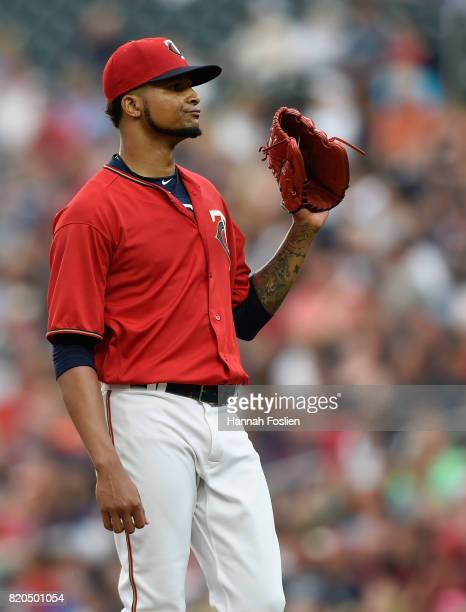 Ervin Santana of the Minnesota Twins reacts after giving up a solo home run to Victor Martinez of the Detroit Tigers during the second inning of the...