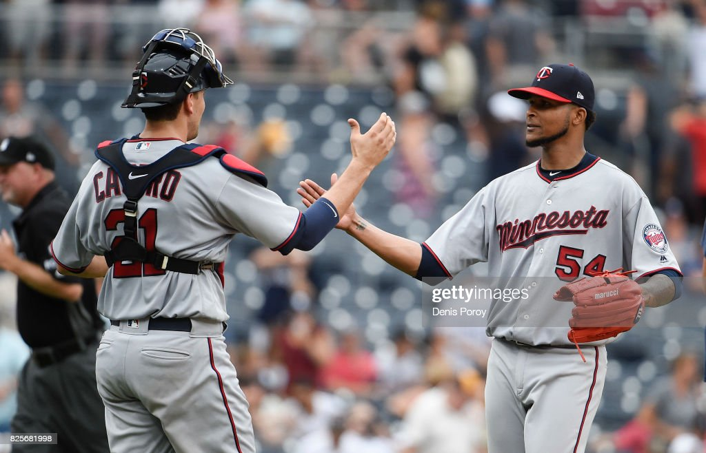 Ervin Santana #54 of the Minnesota Twins , right, is congratulated by Jason Castro #21after getting the final out during the ninth inning of a baseball game against the San Diego Padres at PETCO Park on August 2, 2017 in San Diego, California. The Twins won 5-2.