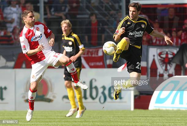Ervin Skela of Cottbus battles for the ball with Gonzalo Castro of Leverkusen during the Bundesliga match between FC Energie Cottbus and Bayer 04...