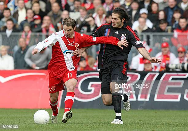 Ervin Skela of Cottbus battles for the ball with Hamit Altintop of Munich during the Bundesliga match between FC Energie Cottbus and FC Bayern Munich...