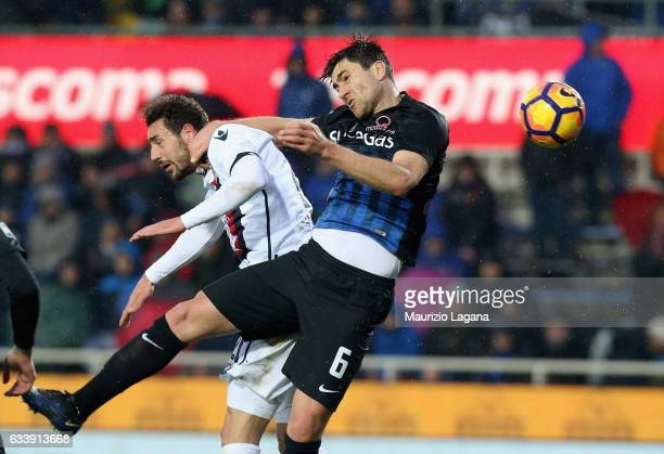 Ervin Zukamovic of Atalanta competes for the ball in air with Artur Ionita of Cagliari during the Serie A match between Atalanta BC and Cagliari...