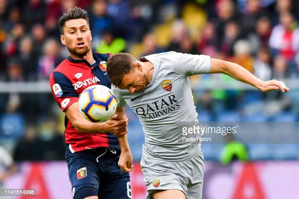 Ervin Zukanovic of Genoa and Edin Dzeko of Roma vie for the ball during the Serie A match between Genoa CFC and AS Roma at Stadio Luigi Ferraris on...