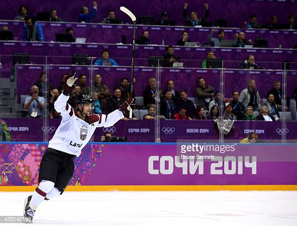 Ervins Mustukovs of Latvia scores a open net goal late in the third period against Switzerland during the Men's Ice Hockey Qualification Playoff game...