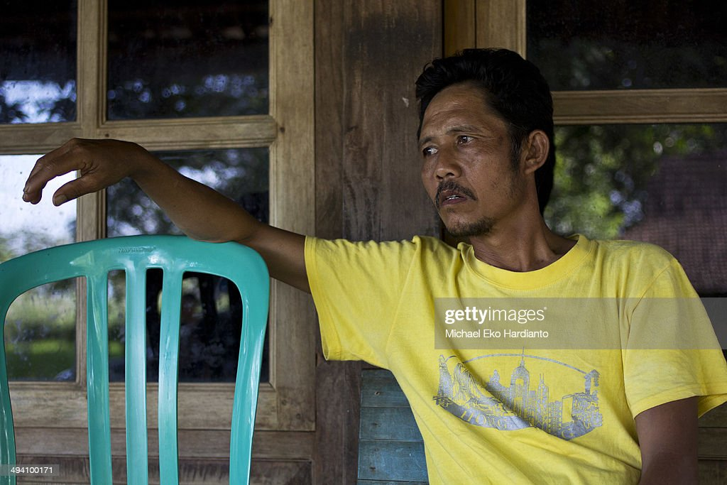 Erwiana's father, Rohmad Saputro relaxes at his home on May 27, 2014 in Ngawi, Indonesia. Erwiana Sulistyaningsih has been voted one of 100 most influential people awarded by TIME magazine. She was abused by her employer in Hong Kong. Since returning to Indonesia, her story has spread globally and helped to raise awareness about the treatment of Asian migrant workers. Migrant workers in Hong Kong hold regular demonstrations to fight violence against workers. Currently Erwiana is fighting her former employer in a high profile court case.