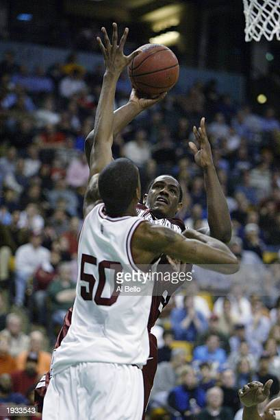 Erwin Dudley of Alabama shoots over Jeff Newton of Indiana during the first round of the NCAA Tournament on March 21 2003 at the FleetCenter in...