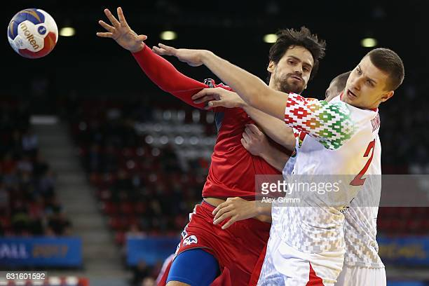 Erwin Feuchtmann of Chile is challenged by Andrei Yurynok of Belarus during the 25th IHF Men's World Championship 2017 match between Belarus and...