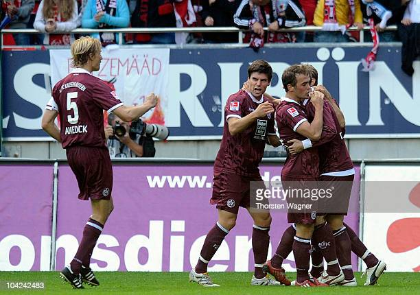 Erwin Hoffer celebrates after scoring the 11 with his team mates during the Bundesliga match between 1FC Kaiserslautern and TSG 1899 Hoffenheim at...