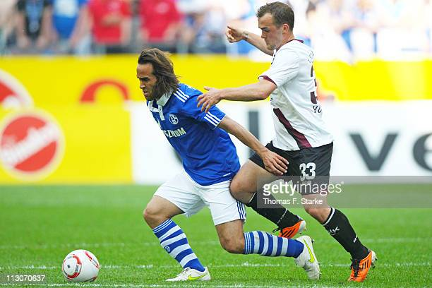 Erwin Hoffer of Kaiserslautern tackles Ali Karimi of Schalke during the Bundesliga match between FC Schalke 04 and 1 FC Kaiserslautern at Veltins...
