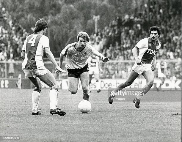 Erwin Koeman Gerald Vanenburg during the match between Ajax and FC Groningen on January 23 1983 at de Meer stadium at Amsterdam Netherlands
