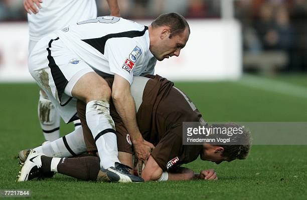Erwin Koen of Paderborn fights for the ball with Marvin Braun of St.Pauli during the Second Bundesliga match between FC St.Pauli and SC Paderborn at...