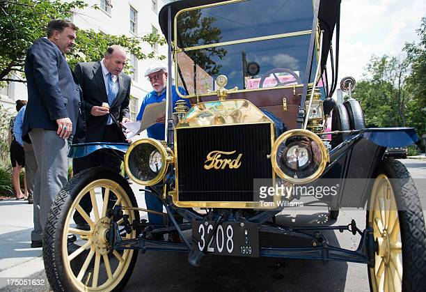 Erwin Mack right of Takoma Park Md talks about his 1909 Ford Model T with Rep Dan Kildee DMich center and Curt Magleby of Ford Motor Company on D...