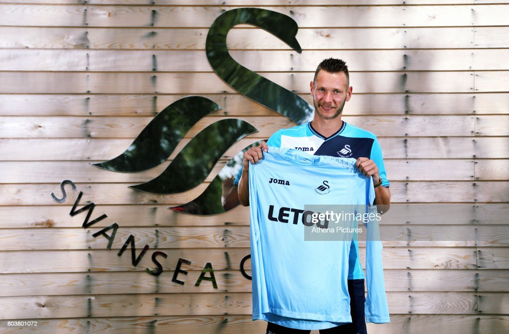 Erwin Mulder holds a shirt at the Swansea City Training at The Fairwood Training Ground on June 19, 2017 in Swansea, Wales.