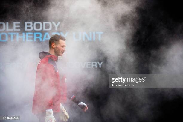 Erwin Mulder walks through steam during the Swansea City training session at The Fairwood training Ground on November 16 2017 in Swansea Wales