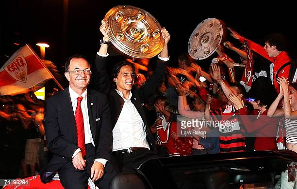 Erwin Staudt president of VfB Stuttgart and Fernando Meira celebrate with their fans during the VfB Stuttgart champion's party at Schloss square on...