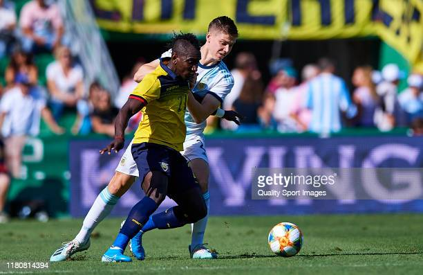 Eryc Castillo of the Ecuador competes for the ball with Juan oyth of Argentina during the international friendly match between Ecuador and Argentina...