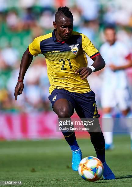 Eryc Castillo of the Ecuador runs with the ball during the international friendly match between Ecuador and Argentina at Estadio Manuel Martinez...