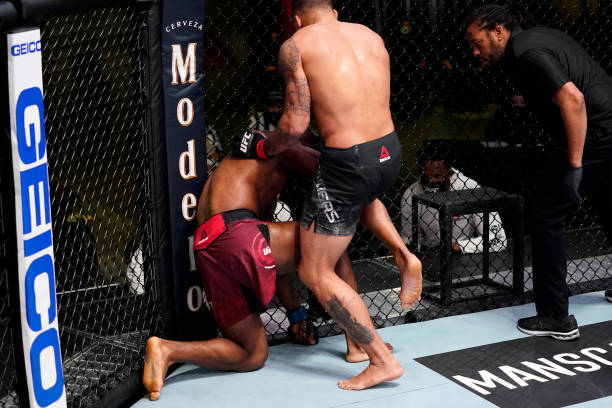 Eryk Anders lands an illegal knee against Darren Stewart of England in a middleweight fight during the UFC Fight Night event at UFC APEX on March 13,...